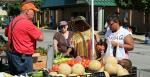 Shoppers at a local farmers market.